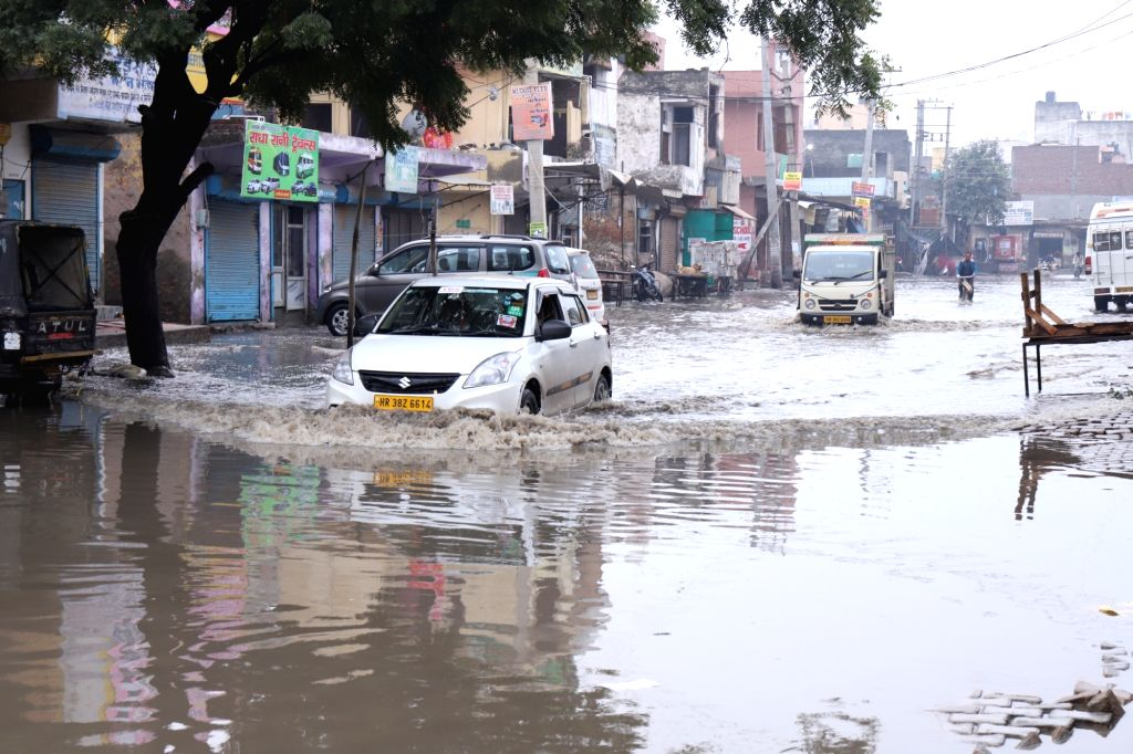 The waterlogged 60 Feet Road End located in Parvatiya Colony after heavy rains lashed Haryana's Faridabad on Dec 13, 2019.