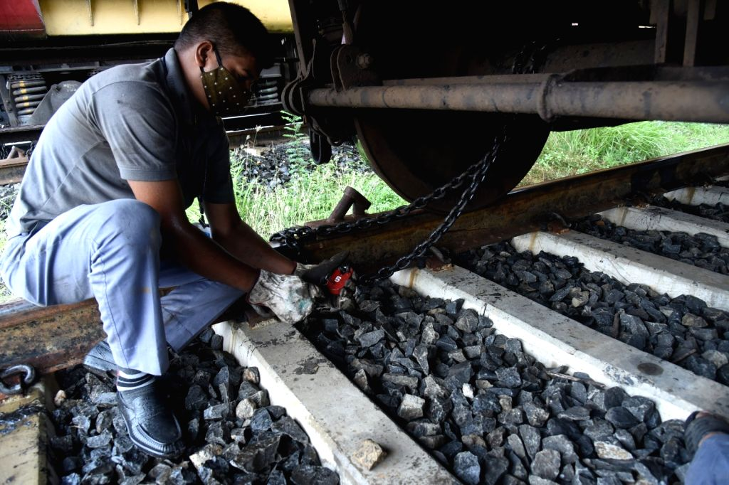 The wheel of the train is chained to protect it from the storm cyclone Yaas at Shalimar Station near Kolkata  25 May, 2021.