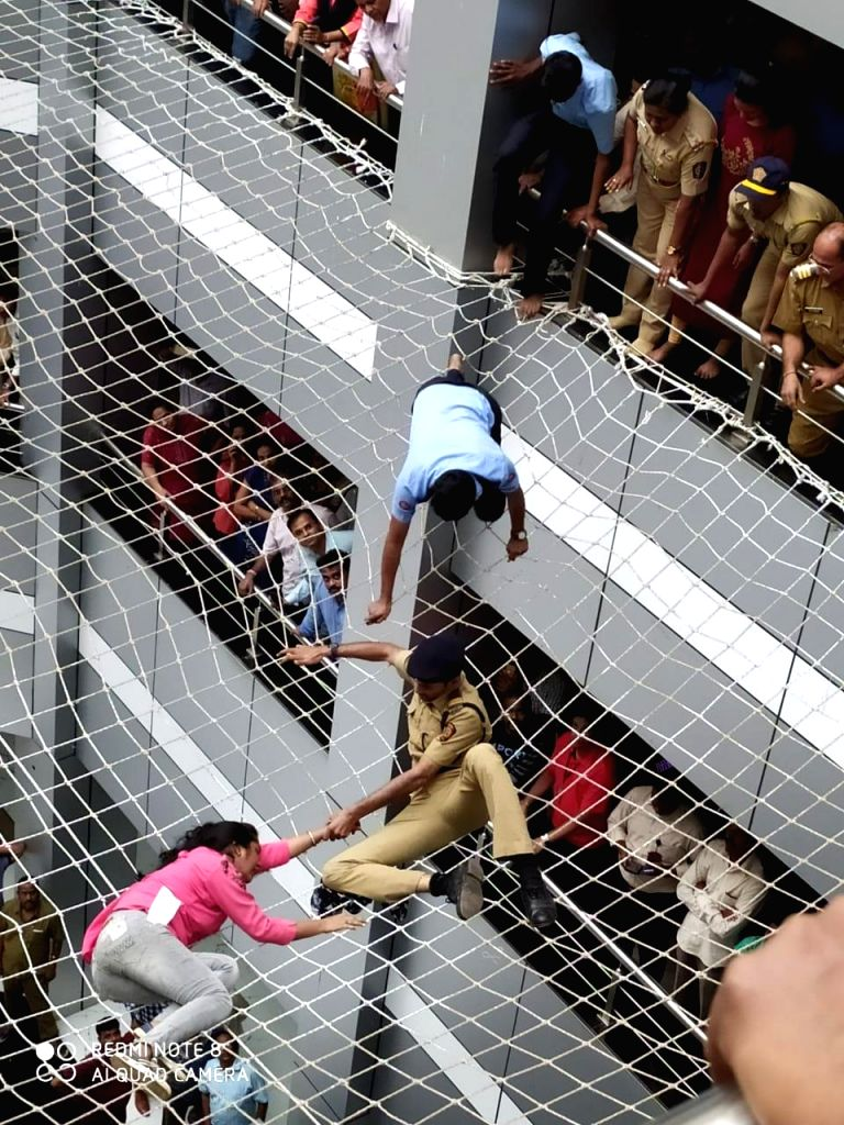 The woman who tried to commit suicide by jumping from the fourth floor of Mantralaya, being rescued after her fatal fall was prevented by the protective wire net, in Mumbai on Dec 13, 2019.