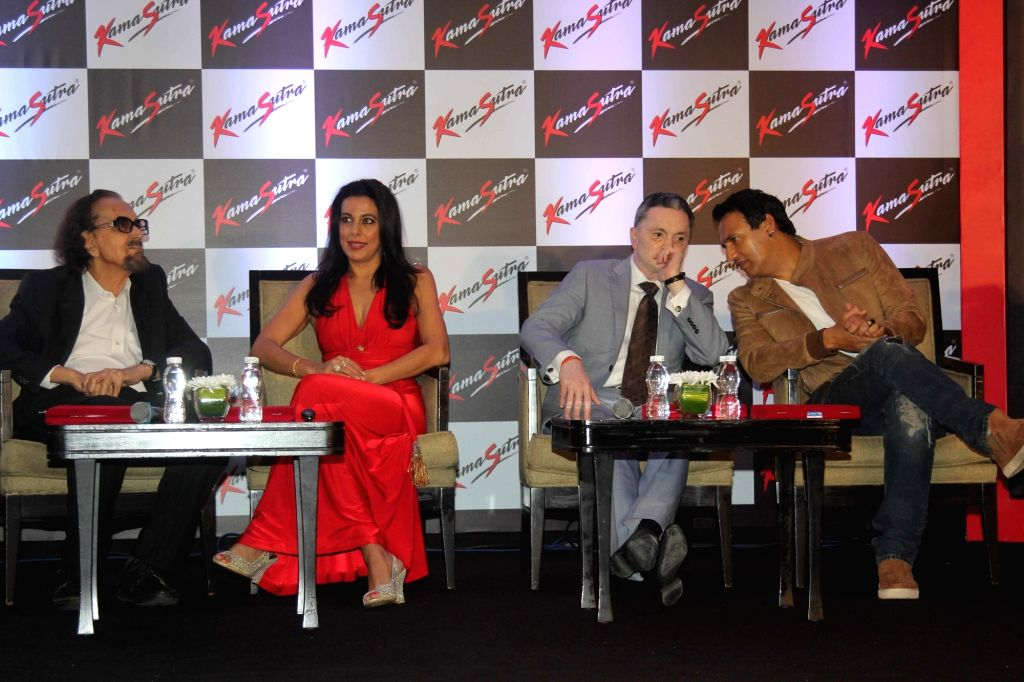 Theater personality and ad filmmaker Alyque Padamsee, actor Pooja Bedi, Gautam Singhania, CMD, Raymond Group and model Marc Robinson during the launch of KamaSutra Honeymoon Surprise Pack, in ... - Pooja Bedi