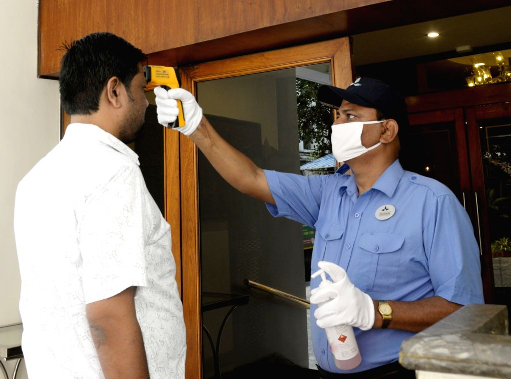 Thermal screening being conducted on visitors for COVID-19 amid coronavirus pandemic, at a hotel in Kolkata on March 18. 2002.