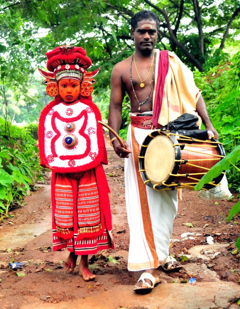 """Theyyam dancers embark on """"grama sancharam"""" - journey through villages- to protect the people from epidemics and bring in fortune during the month of Karkidakam, which is dominated by peak ..."""