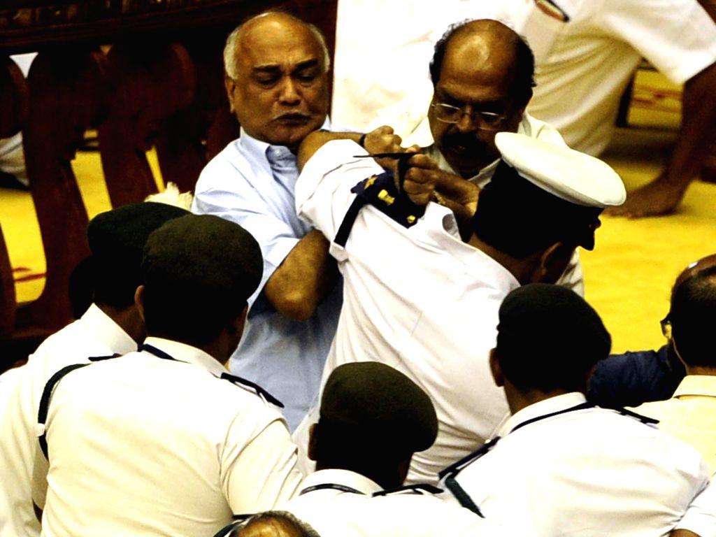 Kerala legislators go berserk in the state assembly during the budget session in Thiruvananthapuram on March 13, 2015.