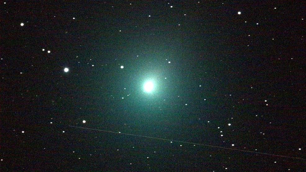 This 120 second image of the comet was taken Dec. 2 by an iTelescope 50 mm refractor located at an observatory near Mayhill, New Mexico. The streak below the comet was produced by a rocket body (upper stage) passing through the telescope's field of v