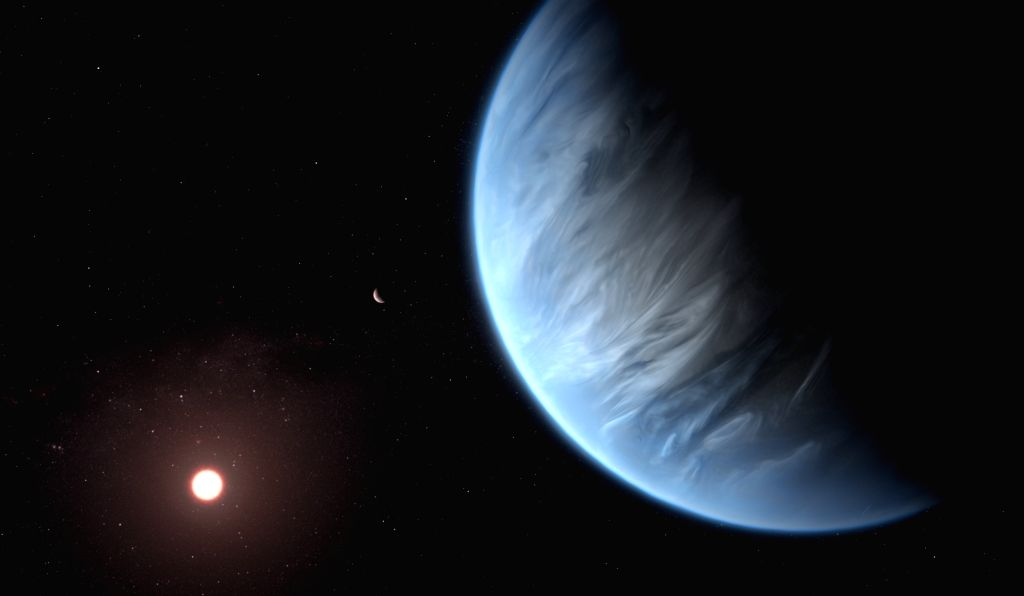 This artist???s impression shows the planet K2-18b, its host star and an accompanying planet in this system. K2-18b is now the only super-Earth exoplanet known to host both water and temperatures ...