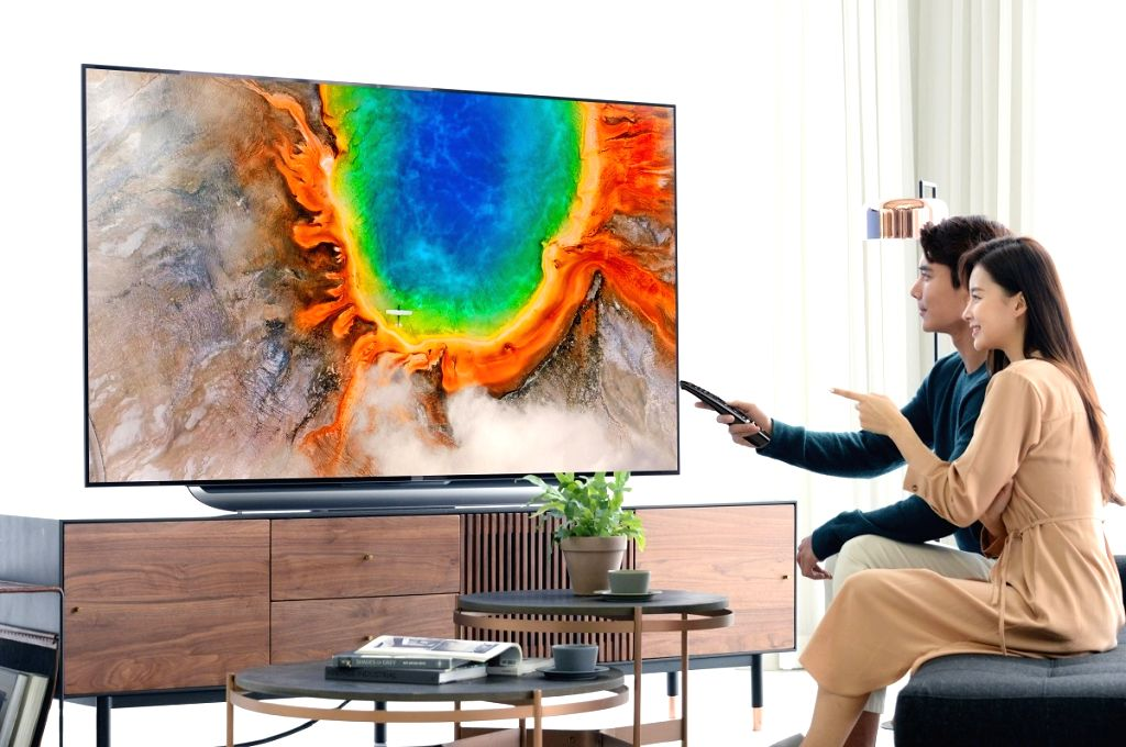 This photo, provided by LG Electronics Inc. on Feb. 25, 2019, shows models introducing the latest version of the company's OLED TV AI ThinQ during a rollout ceremony in Seoul.