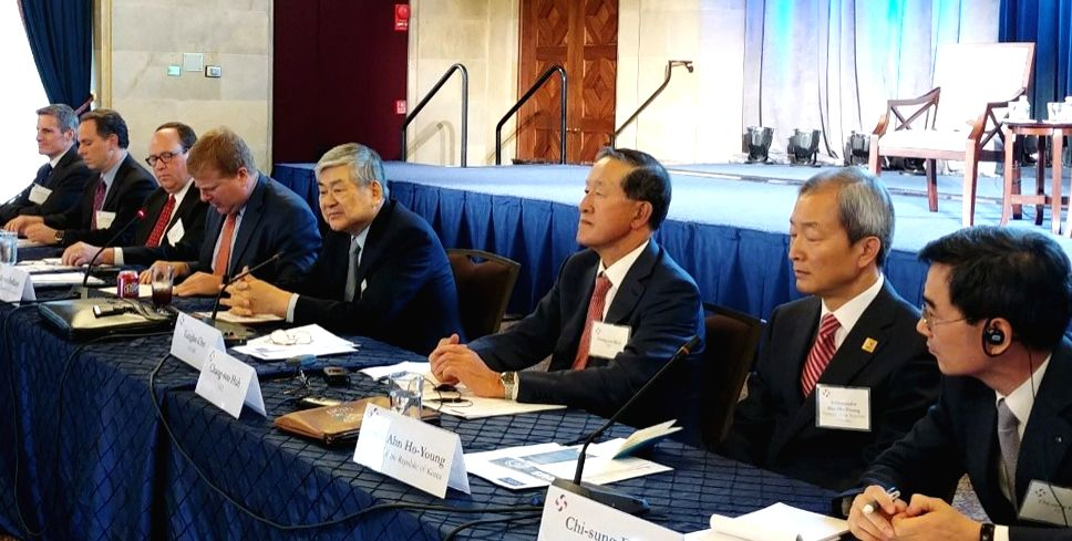 This photo provided by the Federation of Korean Industries on Oct. 11, 2017, shows business leaders from South Korea and the United States listening to a keynote speech delivered by Myron Brilliant, ...