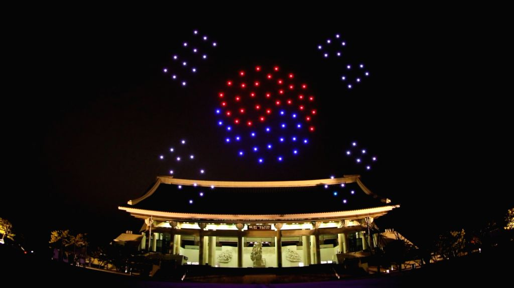 This photo, provided by the Korea Aerospace Research Institute on Feb. 25, 2019, shows 100 drones creating South Korea's national flag over the Independence Hall of Korea in Cheonan, about 90 ...