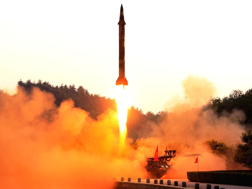 This photo, released by North Korea's official Korean Central News Agency on May 30, 2017, shows a ballistic missile being launched. The North's leader Kim Jong-un observed the missile test and ...