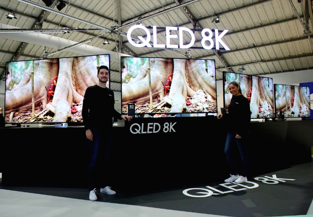 This photo, released by Samsung Electronics Co. on Feb. 24, 2019, shows models showing off its QLED 8K TV. Samsung said it retained the No. 1 spot in the global TV market in 2018 for the 13th ...