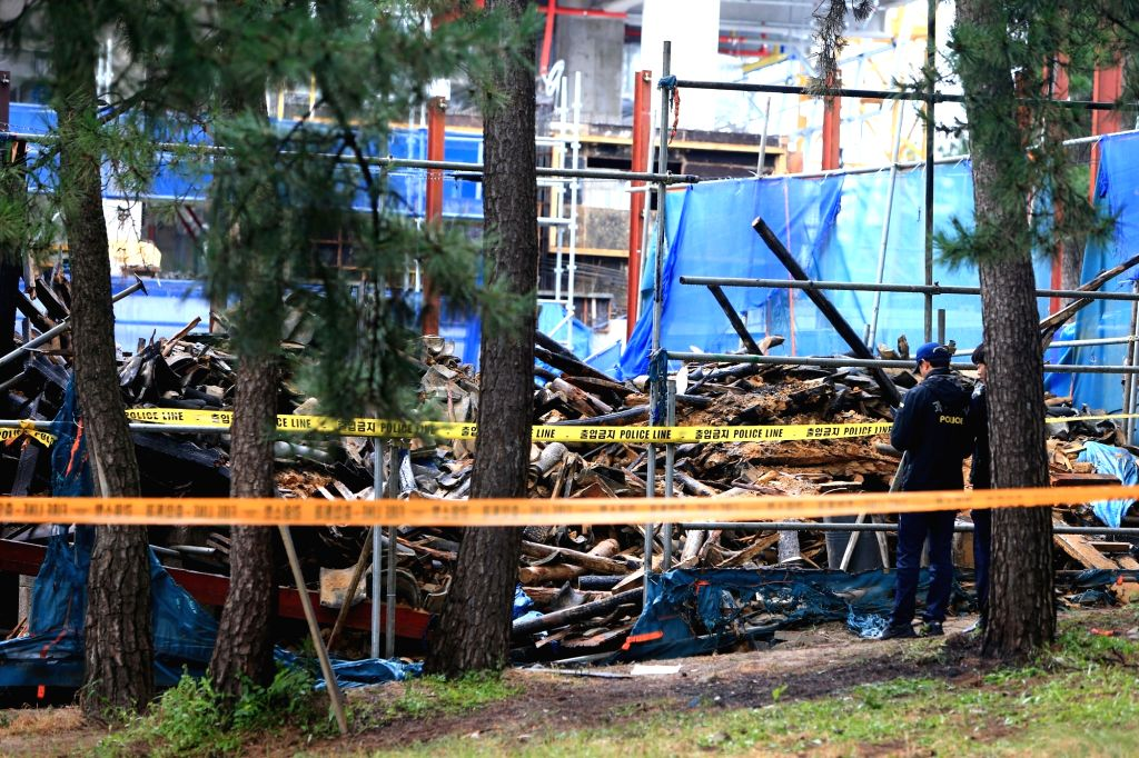 This photo, taken on Sept. 17, 2017, shows the rubble of Seoknan Pavilion in the city of Gangneung on South Korea's east coast after it collapsed following a fire. Two firefighters were killed after ...