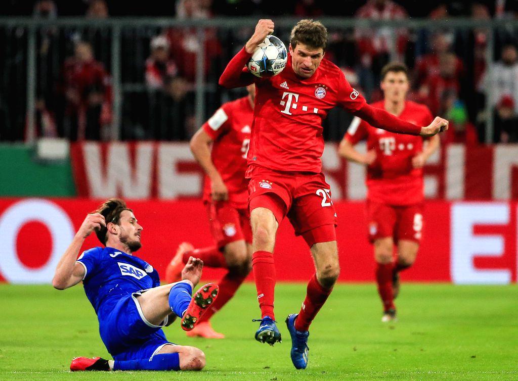 Thomas Mueller (up) of Bayern Munich vies with Havard Nordtveit of Hoffenheim during a German Cup 3rd round match between FC Bayern Munich and TSG 1899 Hoffenheim in ...