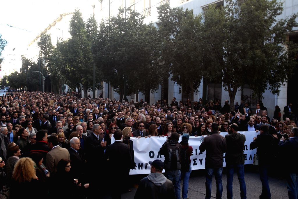 Thousands of lawyers and other professionals shout slogans during a protest against the changes proposed by the government on the new pension plan and the social ...