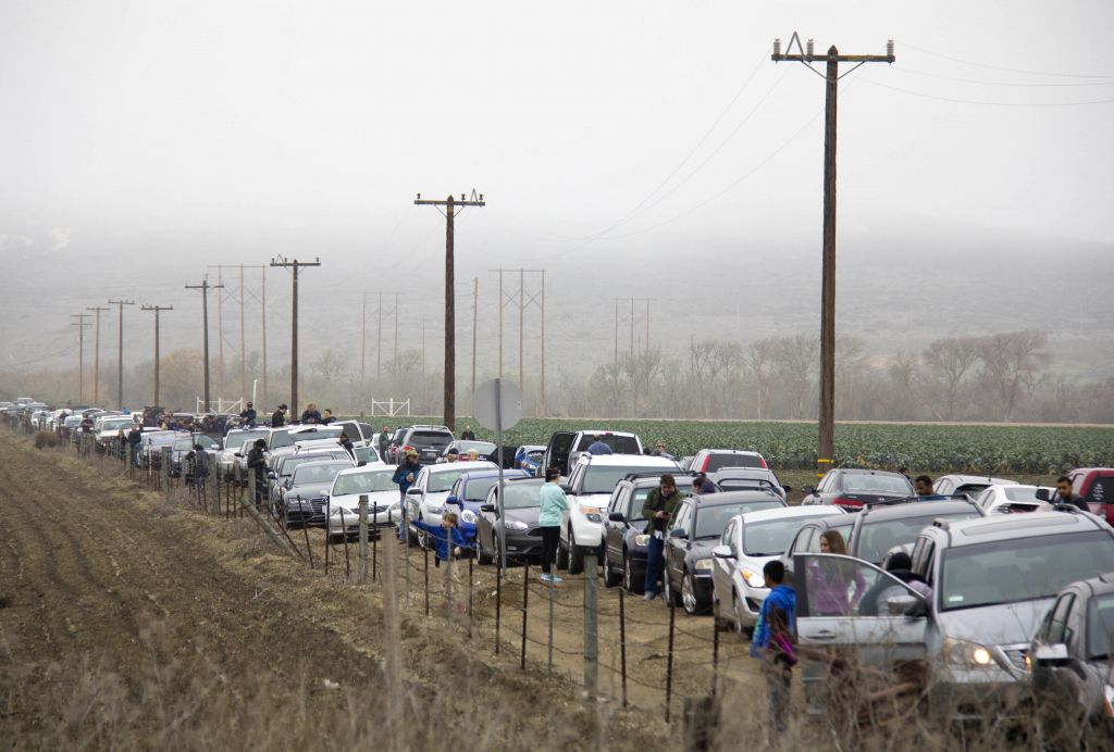 Thousands of people watch the launch of Falcon 9 rocket near Vandenberg Air Force Base in California, the United States, on Jan. 17, 2016. U.S. private spacecraft ...