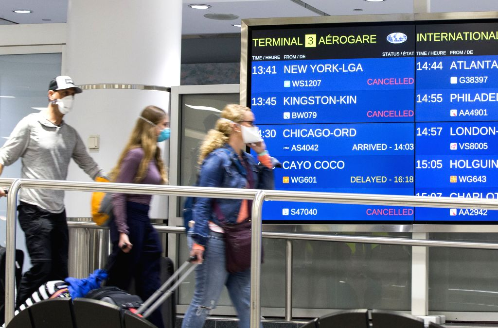 Thousands still flying into Canada despite restrictions