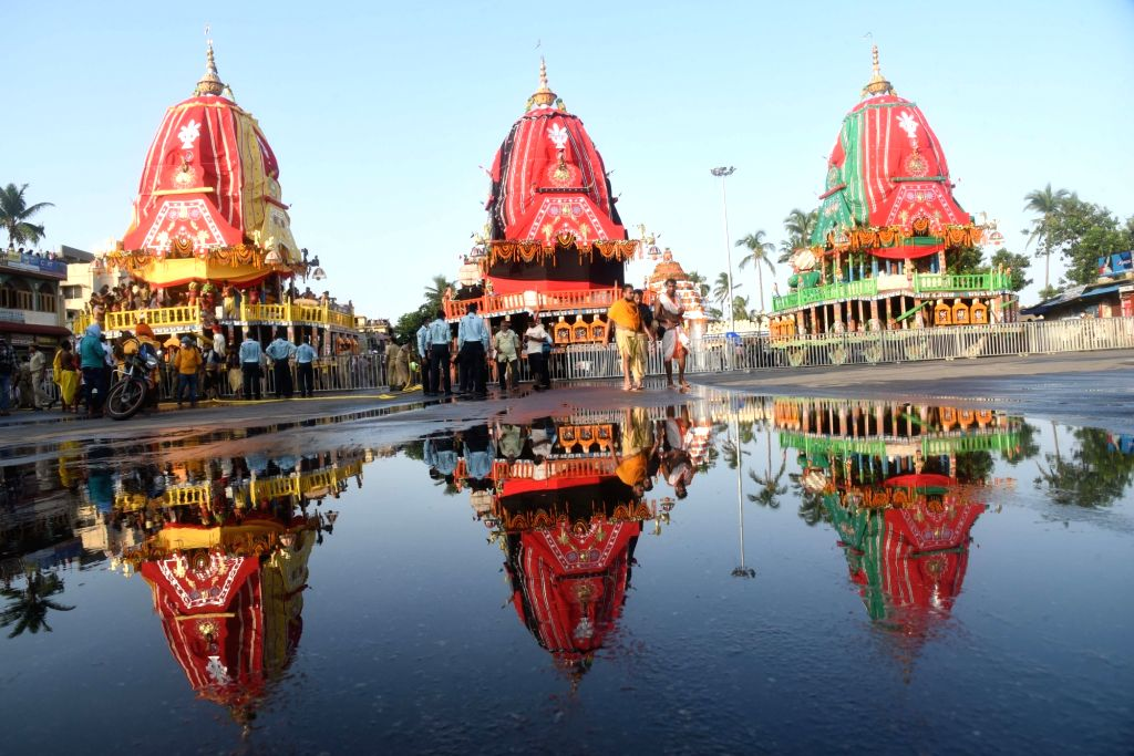 Three majestic wooden chariots carrying Lord Jagannath, Lord Balabhadra and Devi Subhadra reach the Gundicha temple during the annual Rath Yatra, in Puri on June 23, 2020.
