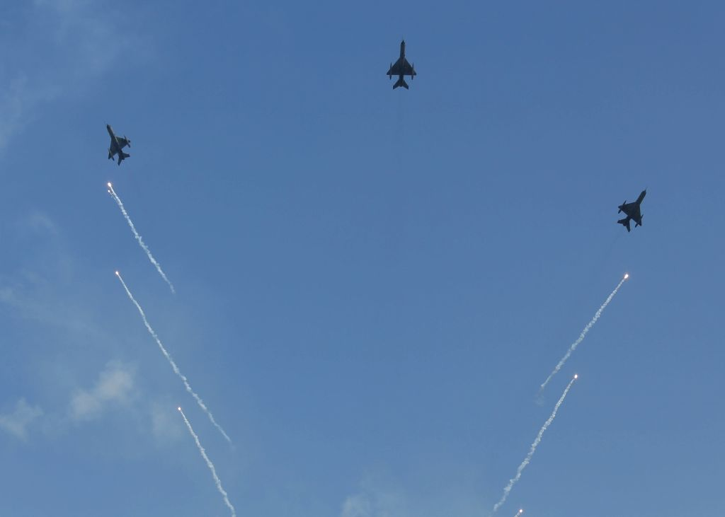 Three MiG-21 Bison fighter jets led by Wing Commander Abhinandan Varthaman participate in flypast during the 87th anniversary celebrations of the Indian Air Force (IAF) at Hindon Air Force ...