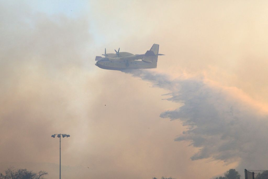 Three people were killed on Thursday when a water-bombing plane fighting bushfires crashed into a large fireball in the Snowy Monaro area, south of the Australian capital, amid rising temperatures that have further fuelled the fires in the country.