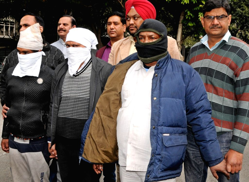 Three persons arrested by Delhi Police's Crime Branch in connection with a woman's murder, in New Delhi on Feb 1, 2019.