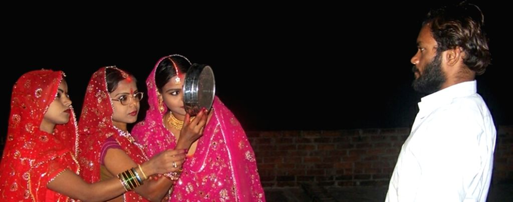 Three sisters celebrate Karva Chauth.
