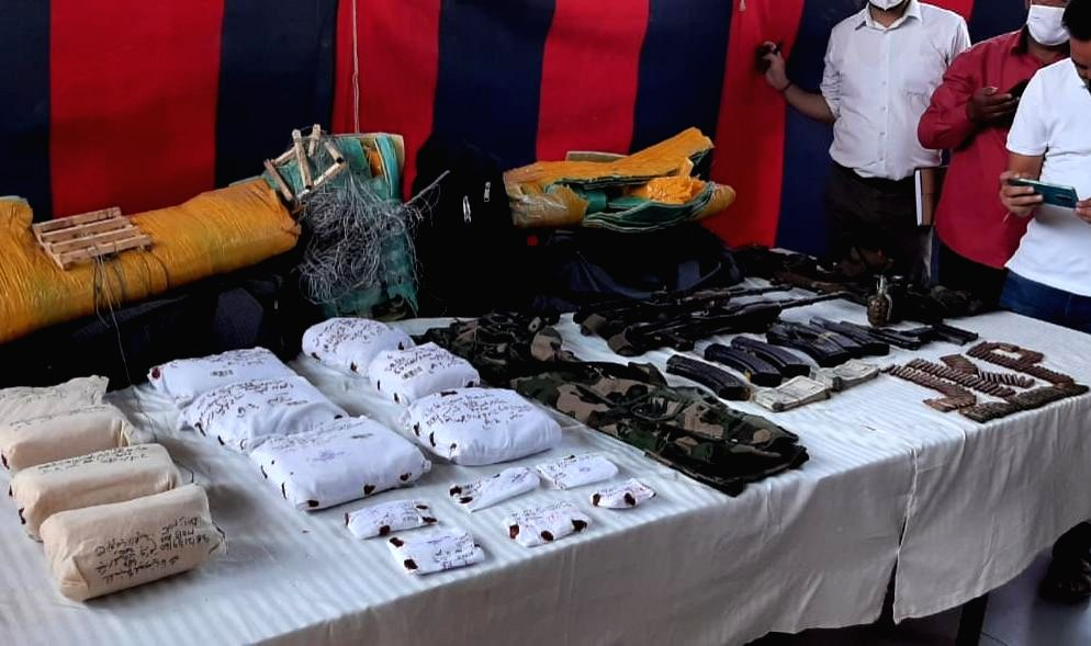 Three suspected Lashkar-e-Taiba terrorists were arrested by the security forces from Rajouri district of Jammu and Kashmir with a large cache of arms and ammunition they had received through ...