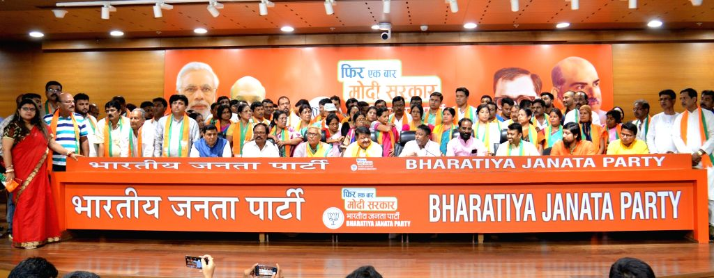 Three Trinamool Congress MLAs including Subhrangshu Roy, Tushar Kanti Bhattacharya and CPI-M MLA Kanti Bhattacharya along with 52 councillors join BJP in the presence of BJP leaders ... - Subhrangshu Roy and Mukul Roy