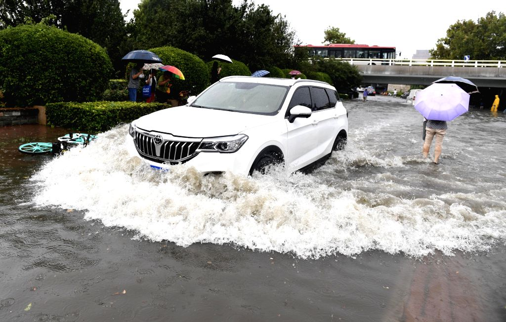TIANJIN, Aug. 2, 2019 - A car wades through a flooded street in Hedong District of Tianjin, north China, Aug. 2, 2019. Some roads in downtown Tianjin were flooded, due to the heavy rain on Friday.