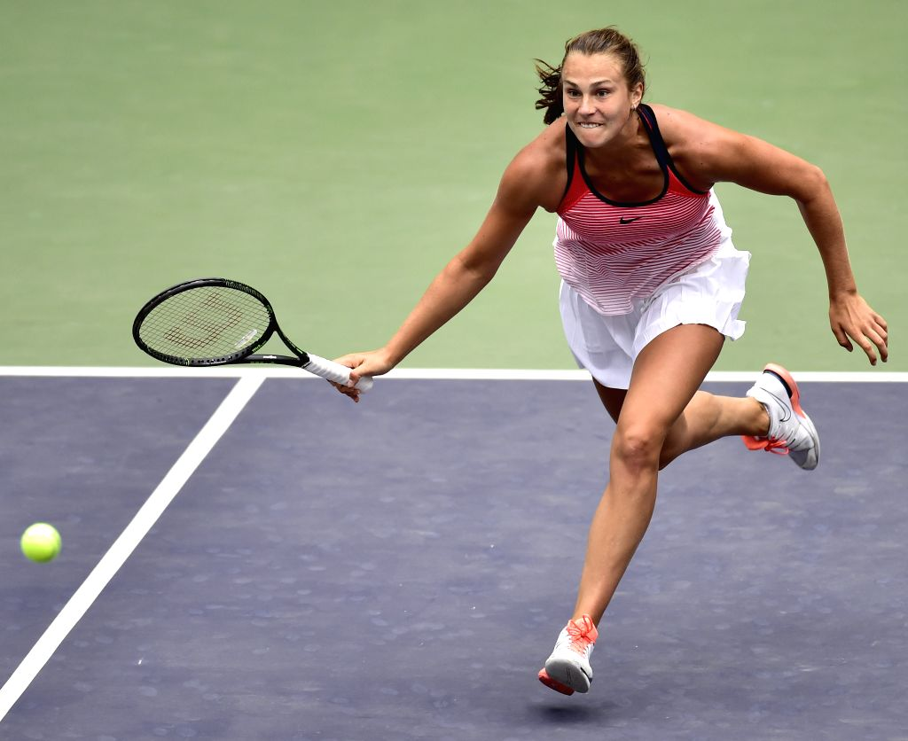 TIANJIN, May 27, 2016 - Aryna Sabalenka of Belarus returns the ball during the singles' quarterfinal against Peng Shuai of China in 2016 ITF Women's Circuit in north China's Tianjin Municipality, on ...