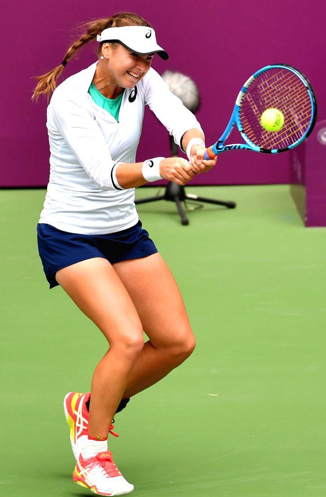 TIANJIN, Oct. 11, 2019 - Rebecca Peterson of Sweden hits a return during the women's singles quarterfinal match against Wang Yafan of China at the WTA Tianjin Open tennis tournament in Tianjin, north ...