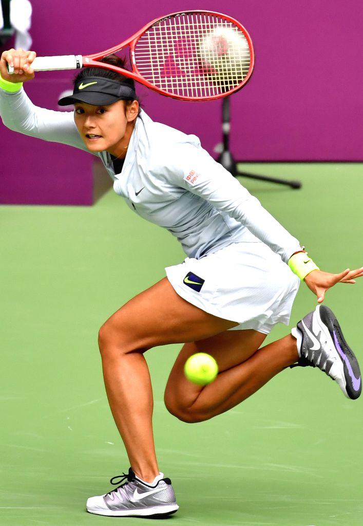 TIANJIN, Oct. 11, 2019 - Wang Yafan of China hits a return during the women's singles quarterfinal match against Rebecca Peterson of Sweden at the WTA Tianjin Open tennis tournament in Tianjin, north ...