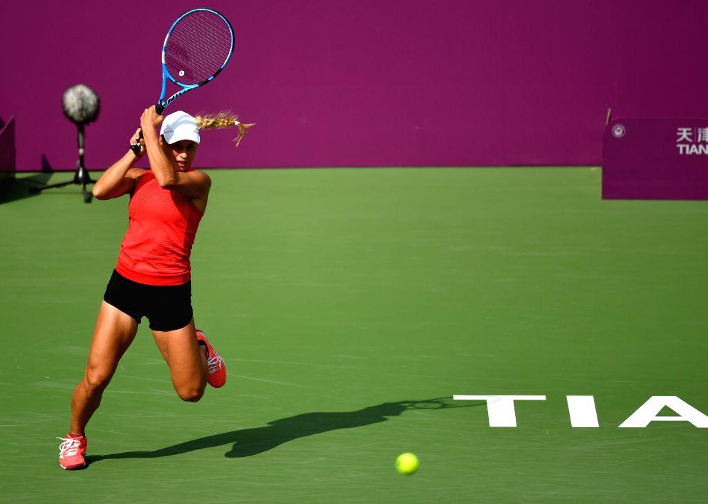 TIANJIN, Oct. 9, 2019 - Yulia Putintseva of Kazakhstan hits a return during the women's singles second round match between Yulia Putintseva of Kazakhstan and Samantha Stosur of Australia at the WTA ...