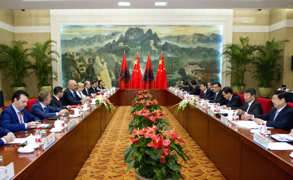 Chinese Premier Li Keqiang (4th R) meets with Albanian Prime Minister Edi Rama (4th L) on the sidelines of the 2014 New Leaders Meeting of the World Economic ... - Edi Rama