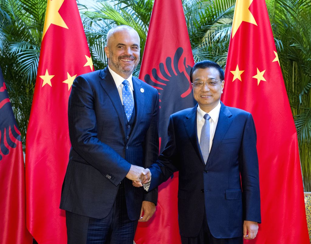 Chinese Premier Li Keqiang (R) meets with Albanian Prime Minister Edi Rama on the sidelines of the 2014 New Leaders Meeting of the World Economic Forum, or the ... - Edi Rama
