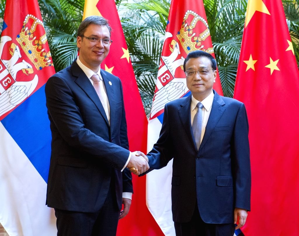Chinese Premier Li Keqiang (R) meets with Serbian Prime Minister Aleksandar Vucic on the sidelines of the 2014 New Leaders Meeting of the World Economic Forum, or . - Aleksandar Vucic