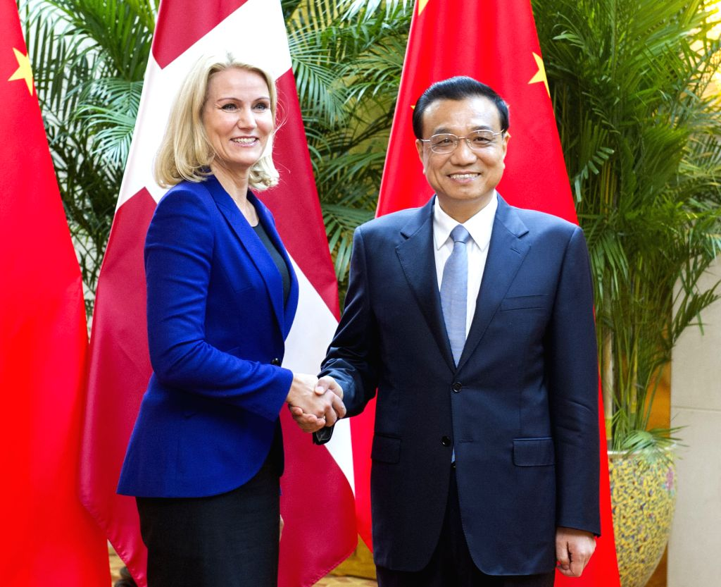 Chinese Premier Li Keqiang (R) meets with Danish Prime Minister Helle Thorning-Schmidt on the sidelines of the Summer Davos in north China' s Tianjin, Sept. 10, ..