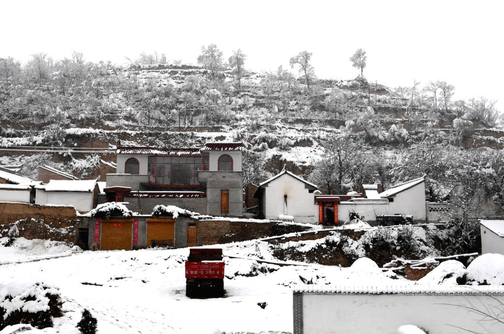TIANSHUI, March 12, 2017 - Photo taken on March 12, 2017 shows snow scenery at a village in Tianshui City, northwest China's Gansu Province.
