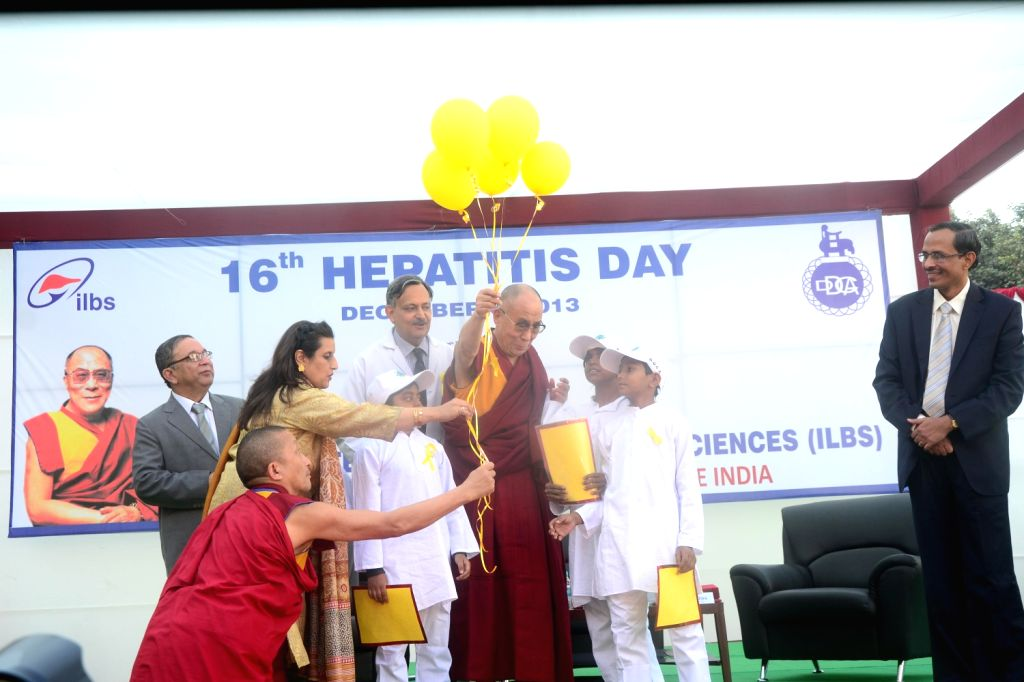 Tibetan spiritual leader Dalai Lama with children during his visit to Delhi on Dec.6, 2013.