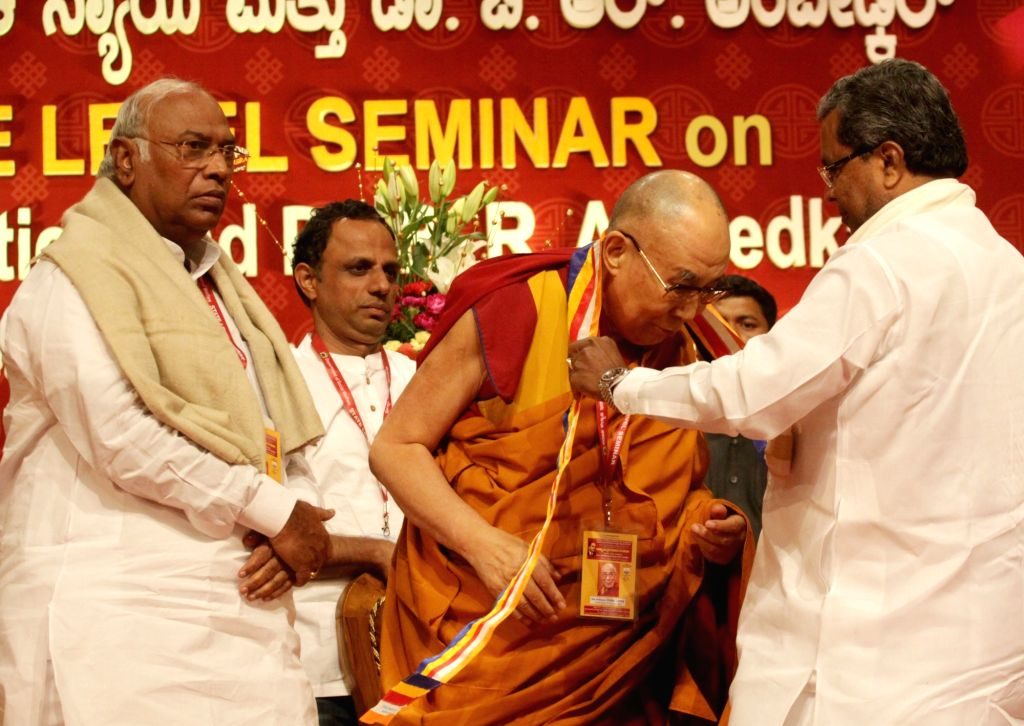Tibetan spiritual leader, the Dalai Lama with Karnataka Chief Minister Siddaramiah and leader of the Congress parliamentary party in Lok Sabha Mallikarjun Kharge during a seminar on Social ... - Siddaramiah