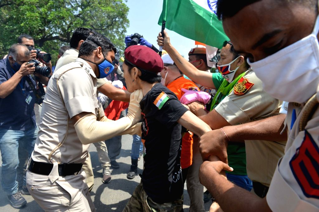 Tibetans in exile being detained by the police as they stage a demonstration against China near the Chinese embassy in New Delhi on July 11, 2020.