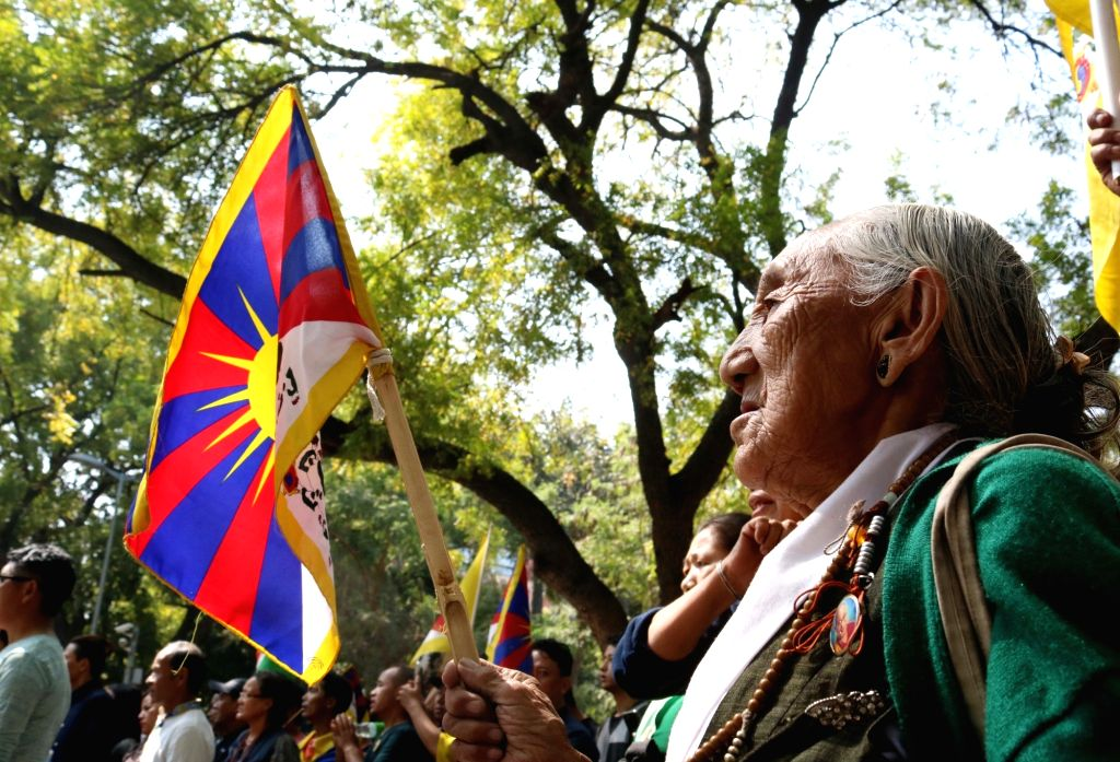 Tibetans in exile participate in a rally organised on 58th Anniversary of the Tibetan National Uprising Day in New Delhi, on March 10, 2017.