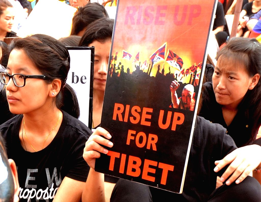 Tibetans in exile participate in a rally organised on 58th Anniversary of the Tibetan National Uprising Day in Bengaluru, on March 10, 2017.
