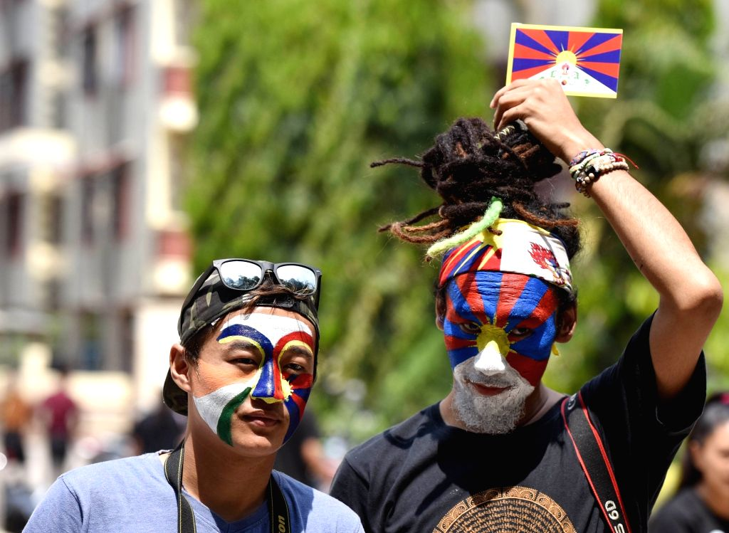 Tibetans in exile participate in a rally organised to mark the 60th anniversary of the Tibetan National Uprising Day, in Bengaluru on March 10, 2019.