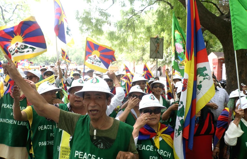 Tibetans participate in a peace march to commemorate the 30th birthday of the 11th Panchen Lama, with a demand of his immediate release from the custody of the Chinese government, in New ...