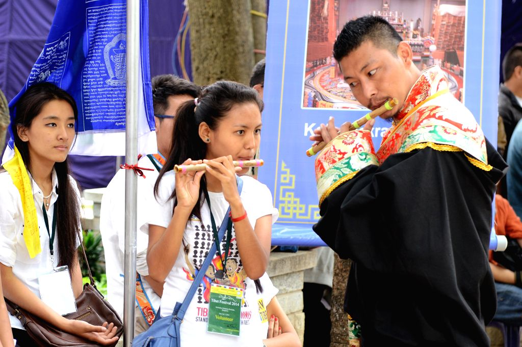 Tibetans perform during inauguration of `Tibet Festival 2014` at Chitrakala Parishath in Bangalore on July 6, 2014.