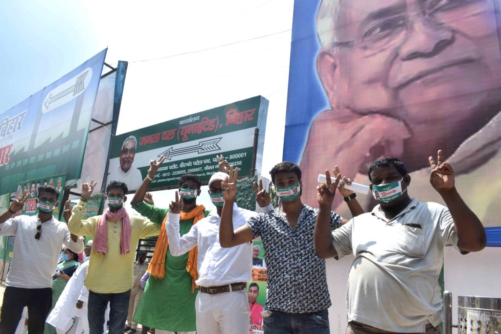 Ticket seekers flash victory sign as they wait outside JD-U office to meet Bihar Chief Minister and party supremo Nitish Kumar ahead of the Bihar assembly elections, in Patna on Sep 28, 2020. - Nitish Kumar