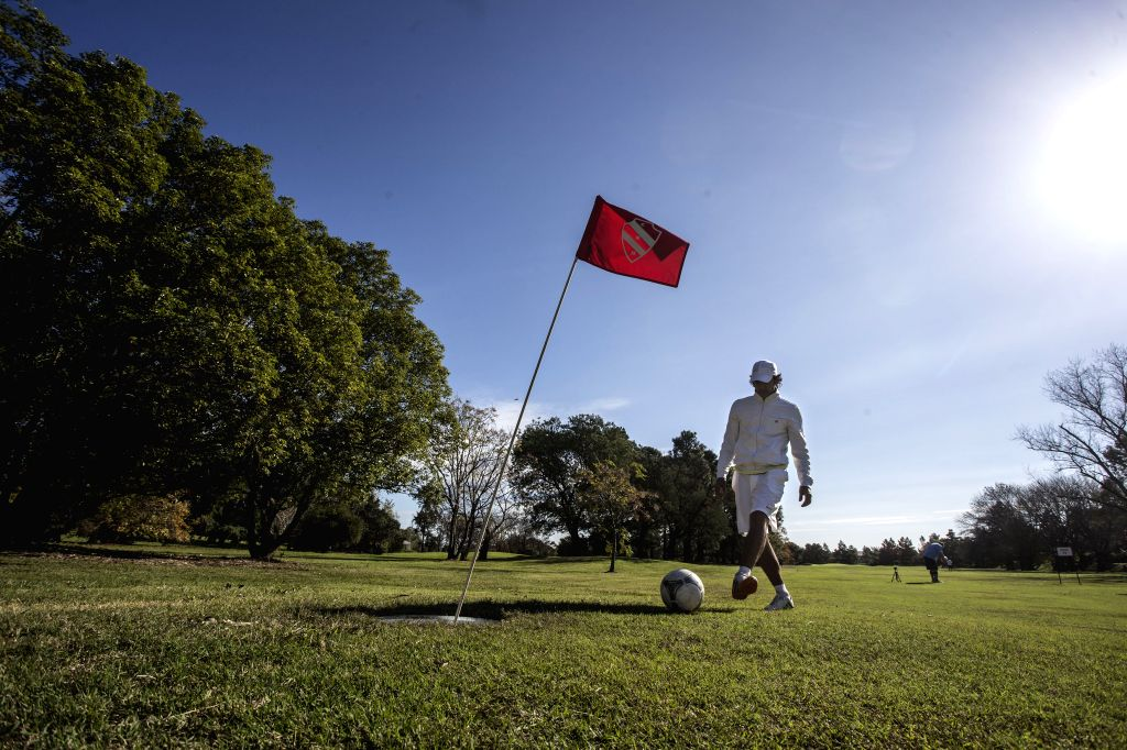 A FootGolf player kicks a ball during a tournament in a golf field of Tigre, 35 kilometers away from Buenos Aires, capital of Argentina, on May 16, 2014. FootGolf is a