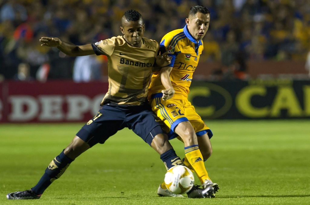 Tigres' Israel Jimenez (R) vies for the ball with Fidel Martinez of Pumas de la UNAM  during the first leg match at the Final of the Opening Tournament of the MX ...