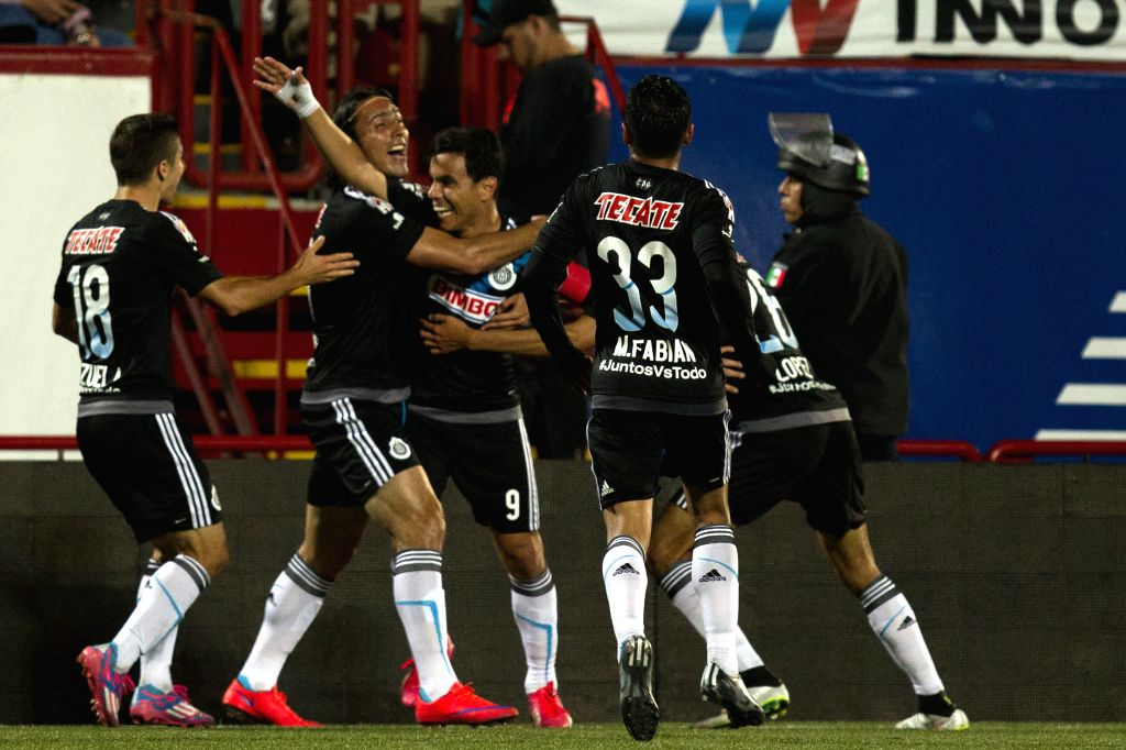Chivas' players celebrate their goal against Xolos during the match at Day 14 of the 2015 Closing Tournament of the MX League, held in the Caliente Stadium in ...