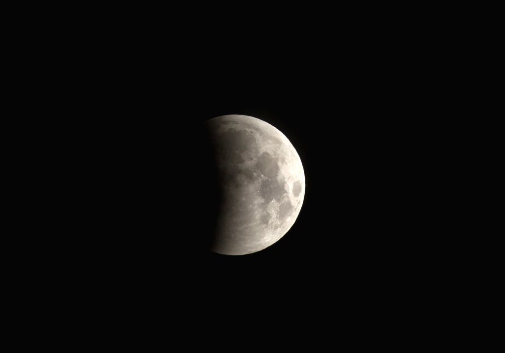 The moon is seen during the first stages of the first total lunar eclipse of the year, in Tijuana City, northeast Mexico, on April 4, 2015. (Xinhua/Guillermo ...