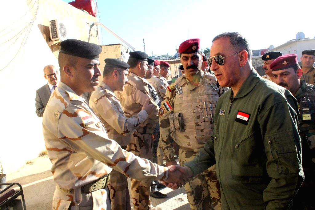 Iraqi Defense Minister Khalid al-Obeidi visits the military camps in Samarra, 120 km north of Baghdad, Iraq, to inspect the progress of the operations in Tikrit to ... - Khalid